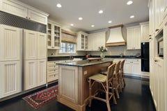 Kitchen with granite and wood island. Kitchen in luxury home with granite and wood island royalty free stock photo