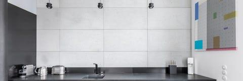 Kitchen with granite worktop Royalty Free Stock Photos