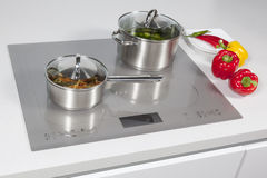 In the kitchen. Grey glass induction hob in the kitchen stock photo