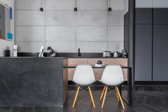 Kitchen with grey wall tiles Stock Photo