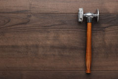 Kitchen hammer on the wooden table Stock Photography