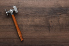 Kitchen hammer on the wooden table Royalty Free Stock Photography