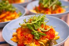 Cooking pasta, sumptuous dinner, Italian tomato seafood noodles,. The kitchen has been cooked in the wobbled dinner, close-up Italian tomato seafood noodles Royalty Free Stock Photos