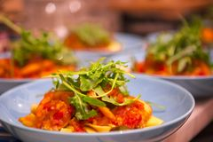 Cooking pasta, sumptuous dinner, Italian tomato seafood noodles,. The kitchen has been cooked in the wobbled dinner, close-up Italian tomato seafood noodles Royalty Free Stock Photo