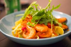 Cooking pasta, sumptuous dinner, Italian tomato seafood noodles,. The kitchen has been cooked in the wobbled dinner, close-up Italian tomato seafood noodles Stock Image