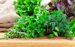 Kitchen herbs on wooden table Royalty Free Stock Images