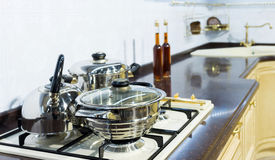 Kitchen hob with pans Stock Images