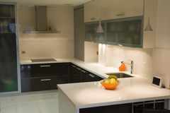 Kitchen II. Modern kitchen with cream and chocolate cupboards and inox hood stock photos
