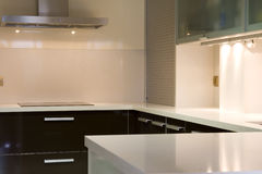Kitchen II. Modern kitchen with cream and chocolate cupboards and inox hood stock image