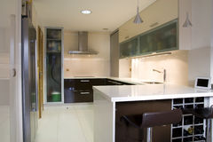 Kitchen II. Modern kitchen with cream and chocolate cupboards and inox hood royalty free stock image