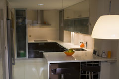 Kitchen III. Modern kitchen with cream and chocolate cupboards and inox hood royalty free stock photography