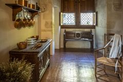 Kitchen In A Medieval Castle With Kitchenware, Furniture And Food On Display. Loire Valley, France Royalty Free Stock Image