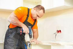 Kitchen installer at carpenter work Royalty Free Stock Photography