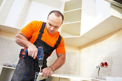 Kitchen installer at carpenter work Royalty Free Stock Images
