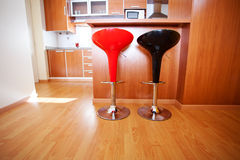 Kitchen interior with bar chairs Stock Photo
