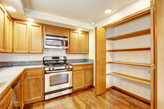 Kitchen interior with built-in shelves Royalty Free Stock Photo