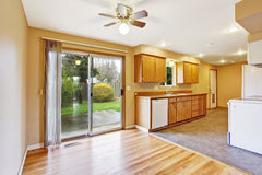 Kitchen interior with dining area in empty house Stock Photography