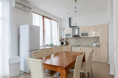 Kitchen interior with dinning room. Interior photography. Stock Photos