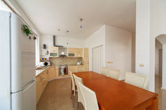 Kitchen interior with dinning room. Interior photography. Royalty Free Stock Photo
