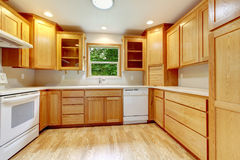 Kitchen interior with hardwood floor, and wood cabinets. Royalty Free Stock Photography