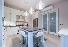 Kitchen Interior with Island, Sink,Tiled Floors in New. Kitchen Interior with Island, Sink, Cabinets,Tiled Floors in New Luxury Home stock photo