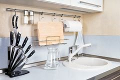 Kitchen Interior with Faucet and Sink. Kitchen Interior with Knife Set, Faucet and Sink and other Equipment royalty free stock images