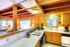 Kitchen interior in log cabin house Stock Images