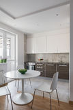 Kitchen interior in modern apartment in scandinavian style Royalty Free Stock Photos
