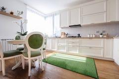 Kitchen interior in a new luxury home. Modern kitchen interior in a new luxury home stock image