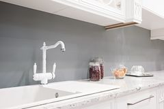 Kitchen interior in new luxury home with touch of retro. Modern appliances.  royalty free stock images