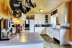 Kitchen interior with peach walls and khaki linoleum Stock Photos