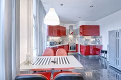 Kitchen interior in red color modern house. Russia Moscow - Modern interior kitchen design of urban real estate Stock Image