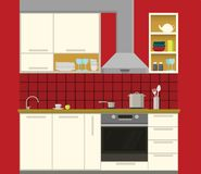 Kitchen. Interior of kitchen with red walls and beige furniture Royalty Free Stock Image