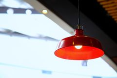 Kitchen interior or restaurant with big red lamp in golden light stock photography