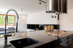 Kitchen interior with sink. Modern kitchen interior with a high-polished countertop and sink stock image