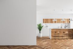 Wooden bar in a white kitchen, mock up wall