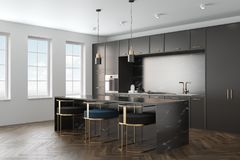 Black marble kitchen interior side. Kitchen interior with a wooden floor, black marble countertops and black cupboards with built in appliances. A black marble Royalty Free Stock Photography
