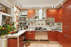 Kitchen interior with wooden furniture Royalty Free Stock Photos