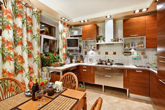 Kitchen interior with wooden furniture and table Stock Photography