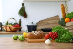Kitchen interiors. Many vegetables and other meal are ready for been cooked soon Royalty Free Stock Photos