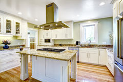 Kitchen island with built-in stove, granite top and hood Stock Image