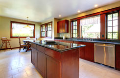 Kitchen with island and dark wood floor. Royalty Free Stock Photography