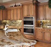 Kitchen island and granite stock photography