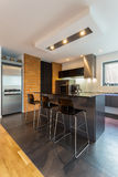 Kitchen island in modern interior Royalty Free Stock Photography