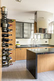Kitchen with island. Stylish wooden kitchen with island and space for wine royalty free stock image