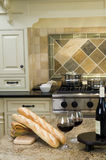 Kitchen island with wine and baguette french bread Stock Images