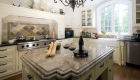 Kitchen island with wine and baguette french bread Royalty Free Stock Photography