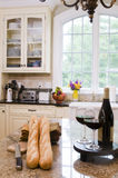 Kitchen island with wine and baguette french bread Royalty Free Stock Photo