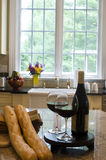 Kitchen island with wine baguettes Stock Photography