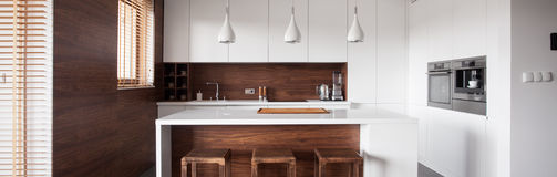 Kitchen island in wood kitchen. Panoramic view of modern style kitchen island in wood kitchen